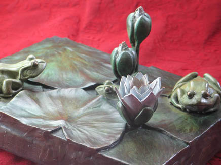 Your pad or mine? Steve Worthington bronze frogs among lillies